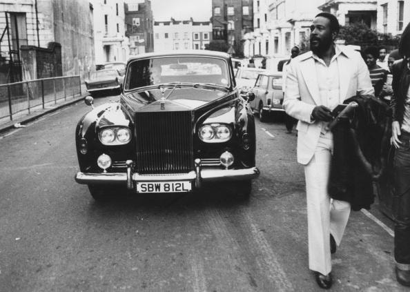 6th October 1976:  American soul singer Marvin Gaye (1939 - 1984) walking ahead of his Rolls Royce in Notting Hill, London.
