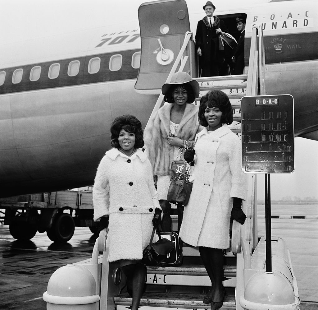 American Motown vocal group Martha And The Vandellas arriving at London Airport (now Heathrow), London, 15th March 1965. Left to right: Rosalind Ashford, Martha Reeves and Betty Kelly. The group are in the UK to take part in the Tamla-Motown Revue tour.